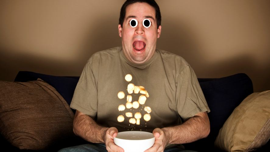 Man being scared with his popcorn flying out of his bowl