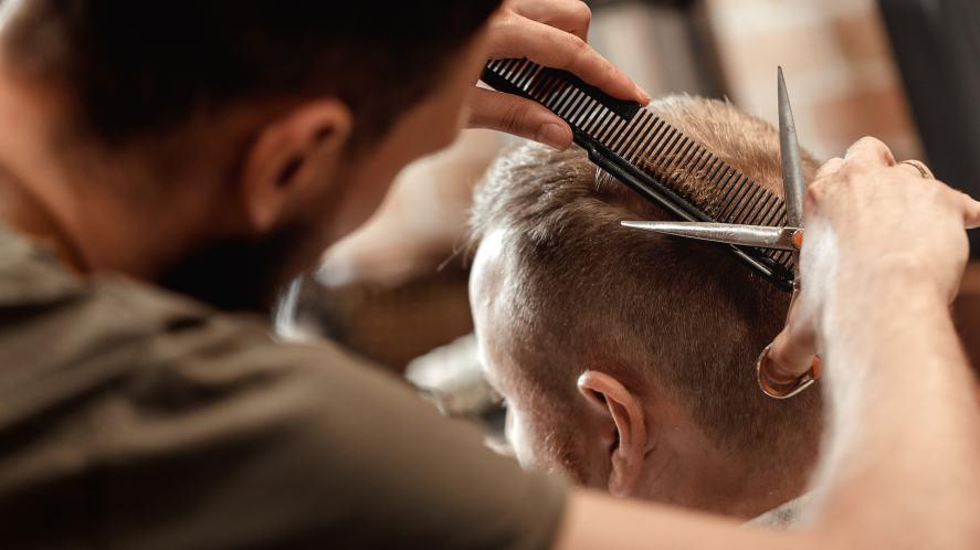 A barber giving a customer a haircut