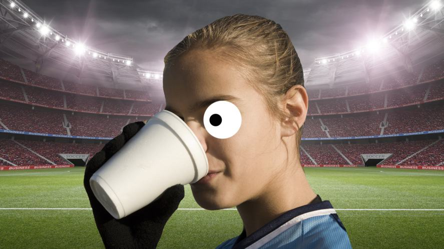 A footballer drinking a cup of tea