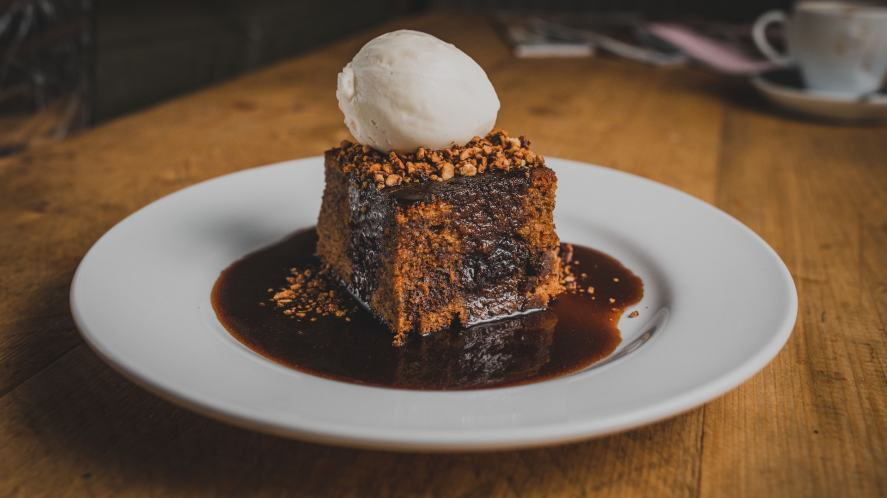A chocolate brownie and ice cream