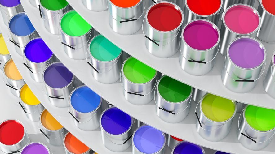 Coloured paints arranged on a shelves