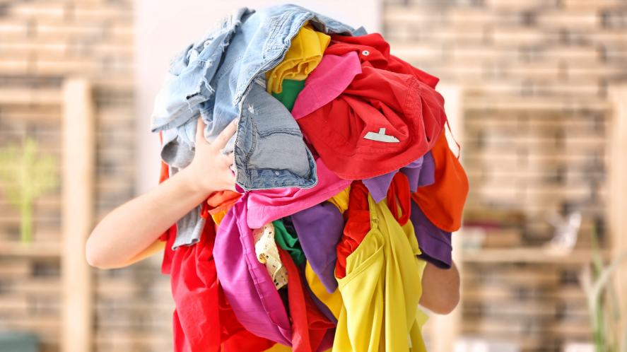 Someone carrying a pile of clothes