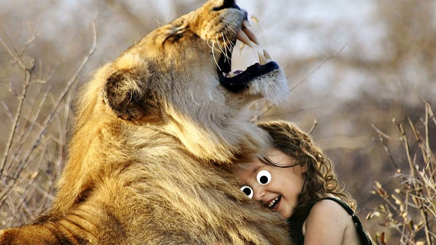 A child and their BBF, which happens to be a lion
