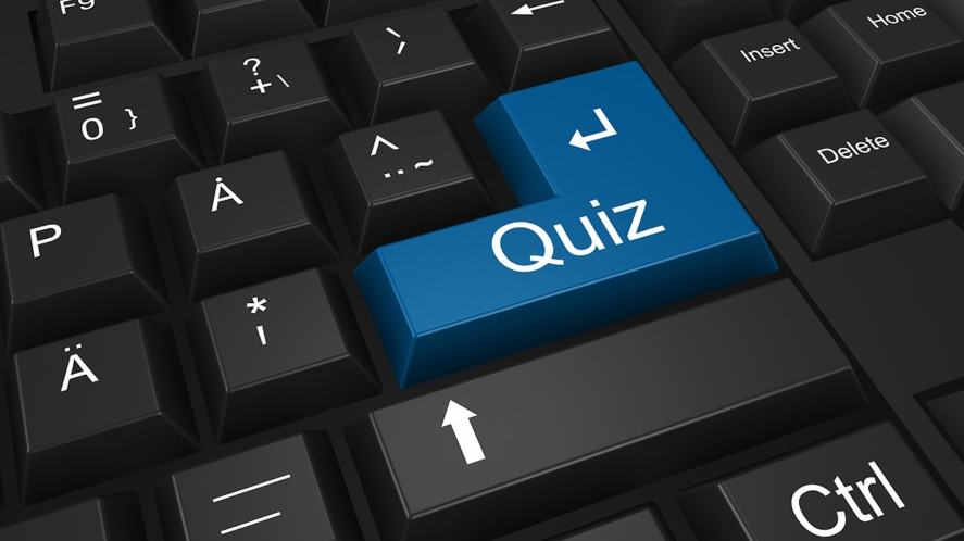 A computer keyboard with a key which says 'quiz'