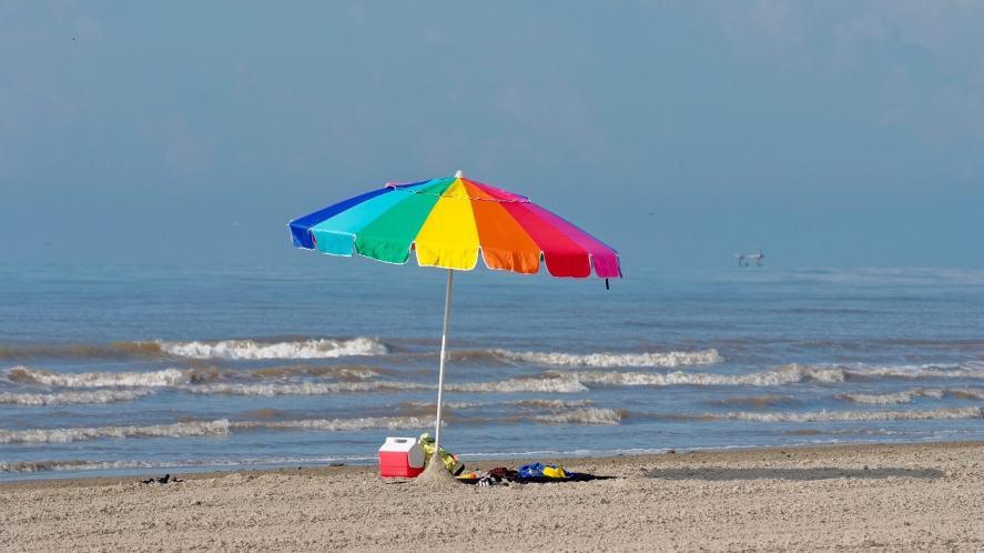 A beach and parasol
