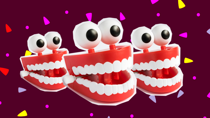 Three chattering teeth toys with googly eyes attached on top
