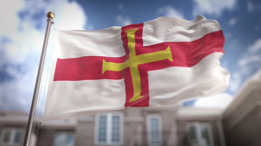 A Guernsey flag fluttering in the wind