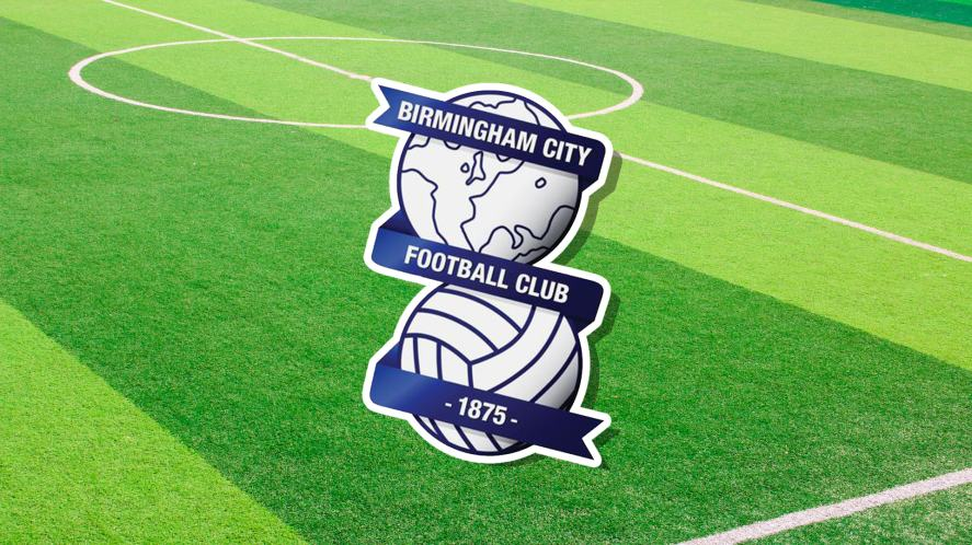 Birmingham City's badge set against a football pitch