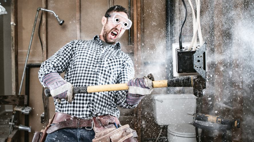 A man quietly doing some home improvements