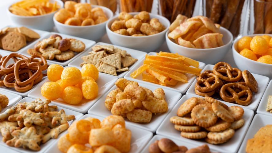 A tray full of crisps and snacks