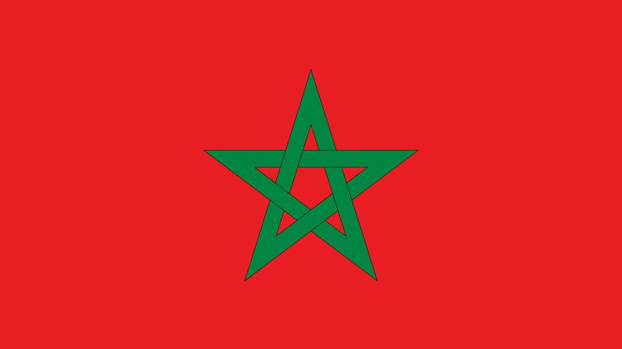 A red flag with a green pentagram