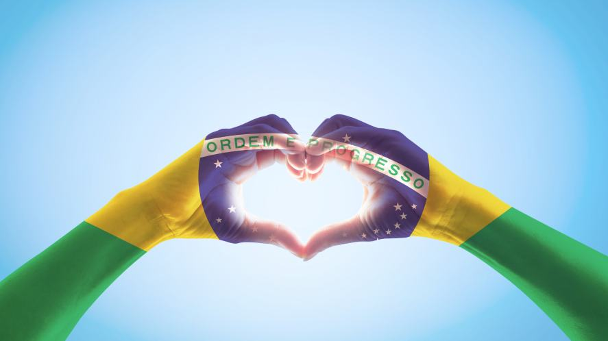 Brazil flag on someone's hands in heart shape