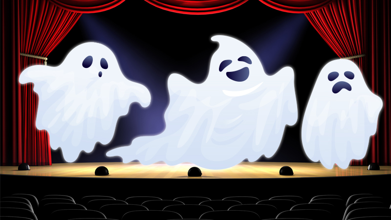 Three white ghosts on a stage