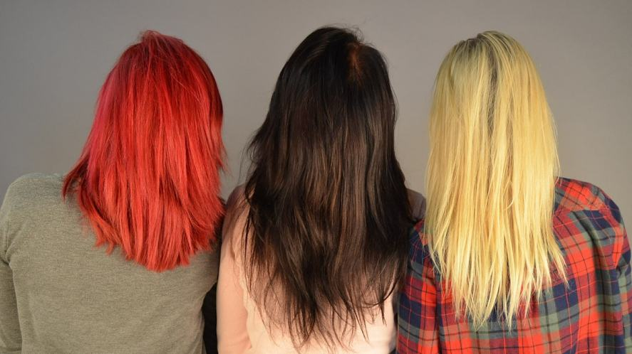 Three people with different coloured hair