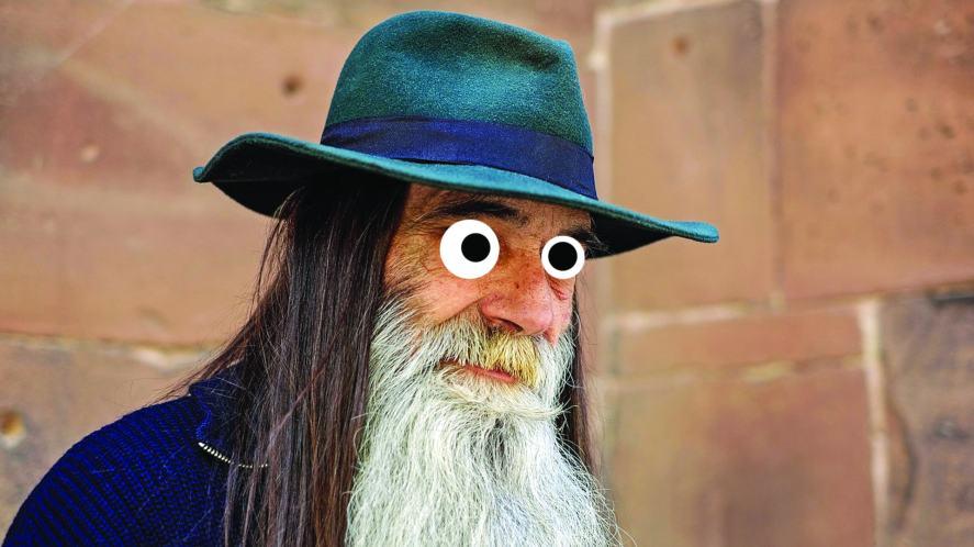 A beardy man wearing a hat