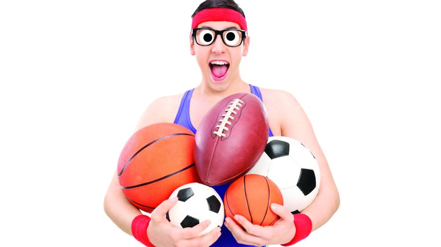 Person with all types of sports ball in their arms