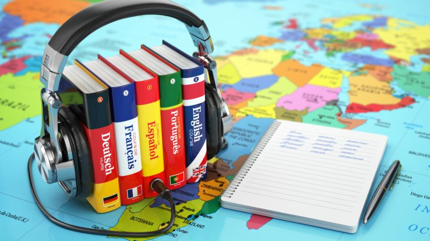 A set of language dictionaries and pair of headphones