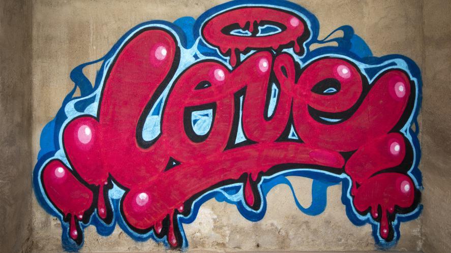 Love: colourful graffiti on a concrete wall