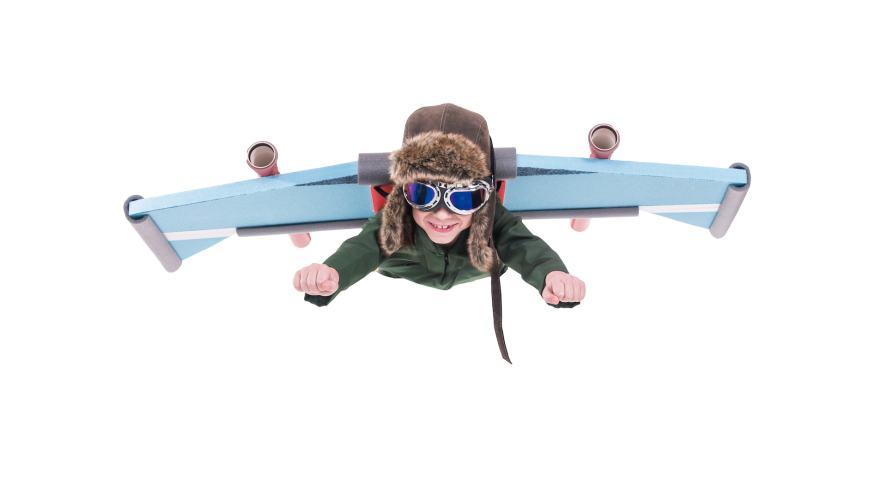 A boy wearing an aeroplane outfit