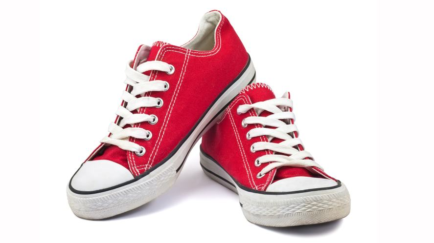A pair of red Converse style trainers