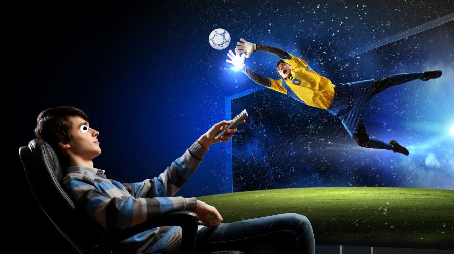 A man watches football on a giant TV