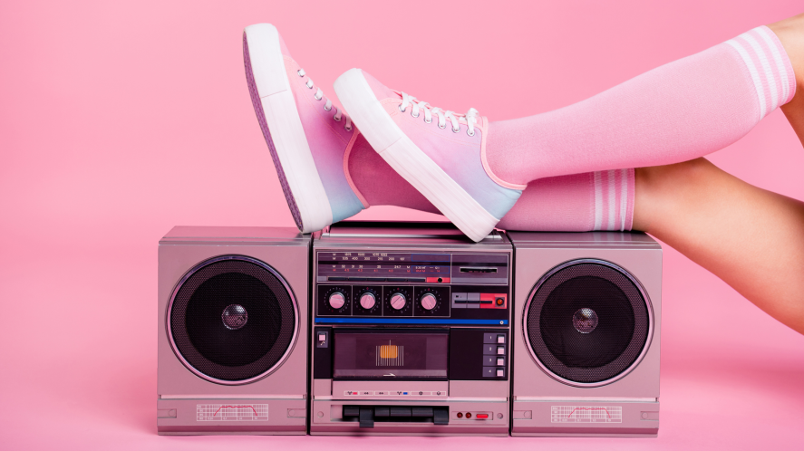 Someone putting their feet up on an old stereo