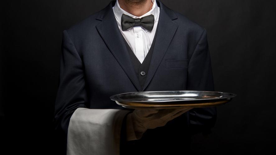 A butler holding a silver tray