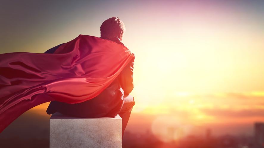 A man wearing a red cape