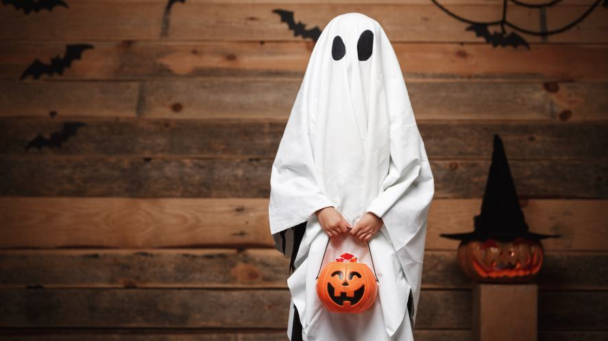 A child dressed as a ghost for Halloween