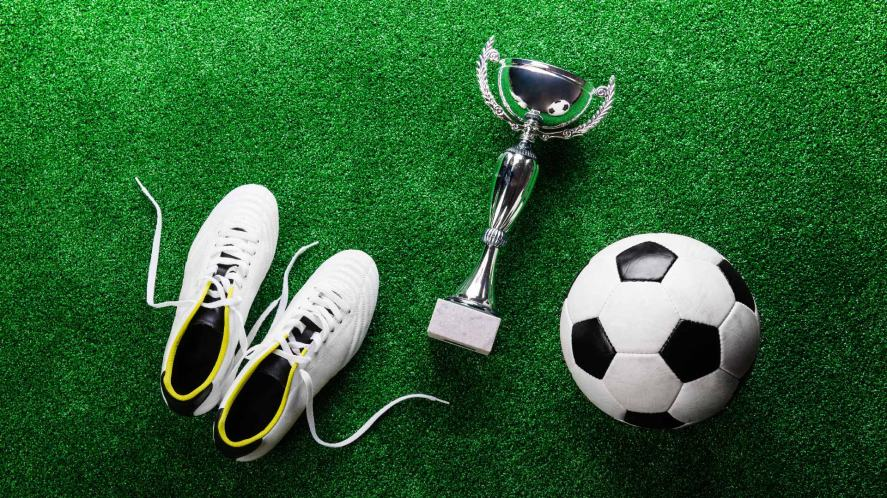 Football boots, a trophy and a football
