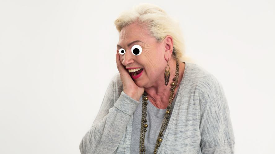 An old lady laughing at a joke