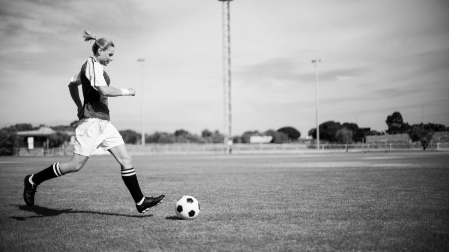 A black and white photo of a game of football