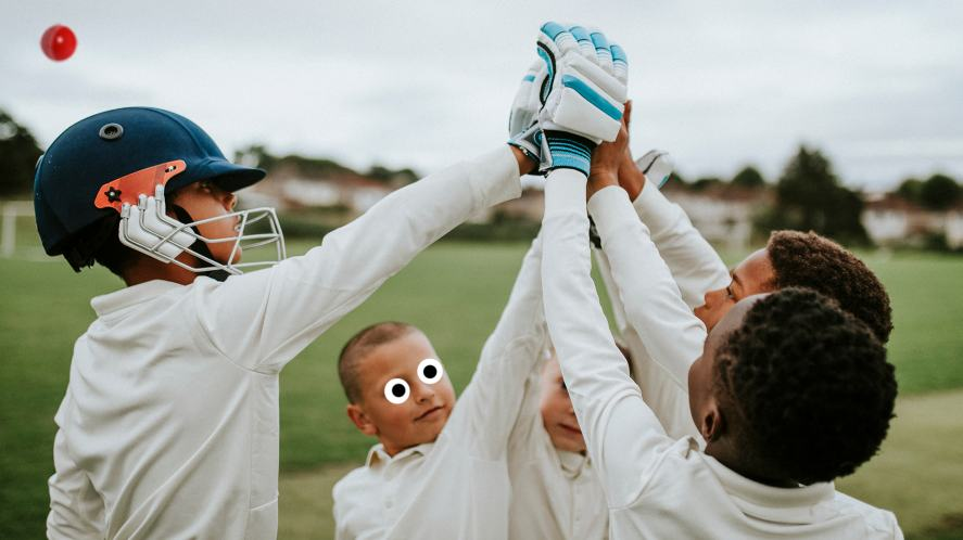 A young cricket team celebrate a win