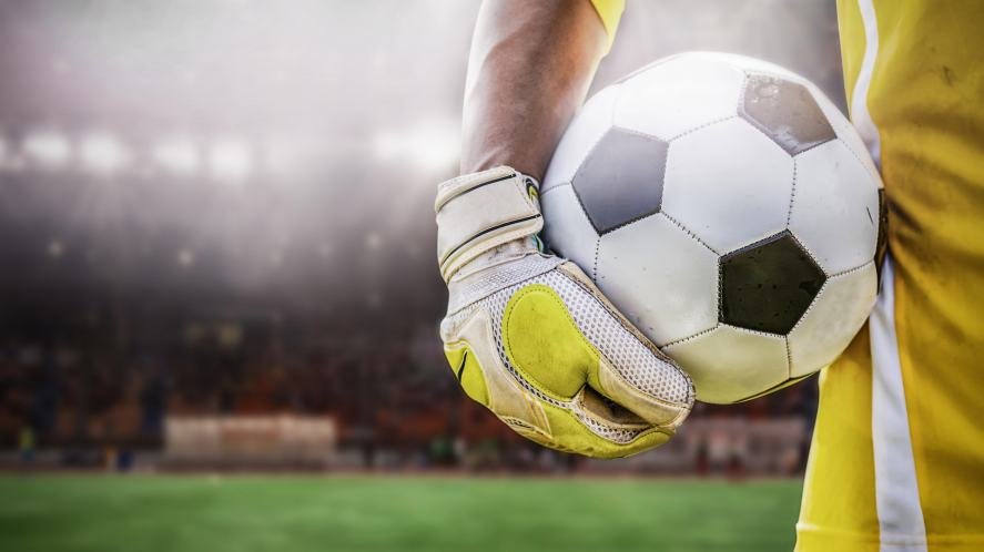 A goalkeeper holding the ball