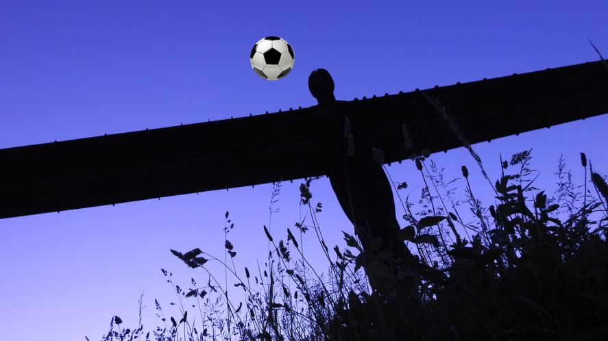 The Angel of the North heads a football