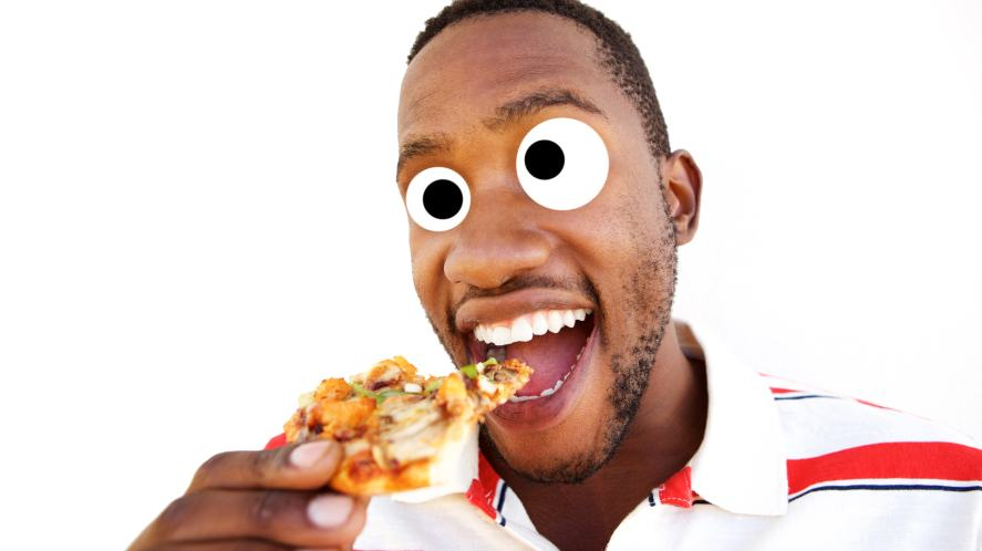 A man eating a slice of pizza
