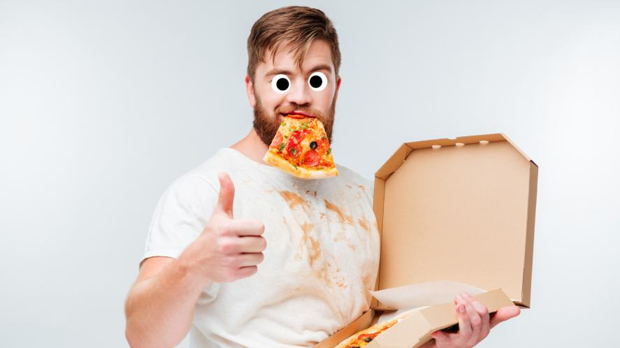 A man eating a greasy pizza