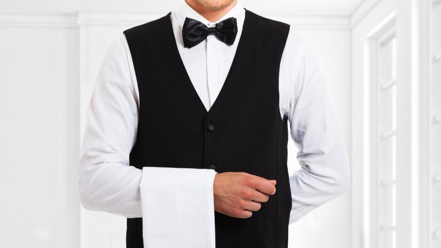 A waiter in a bowtie
