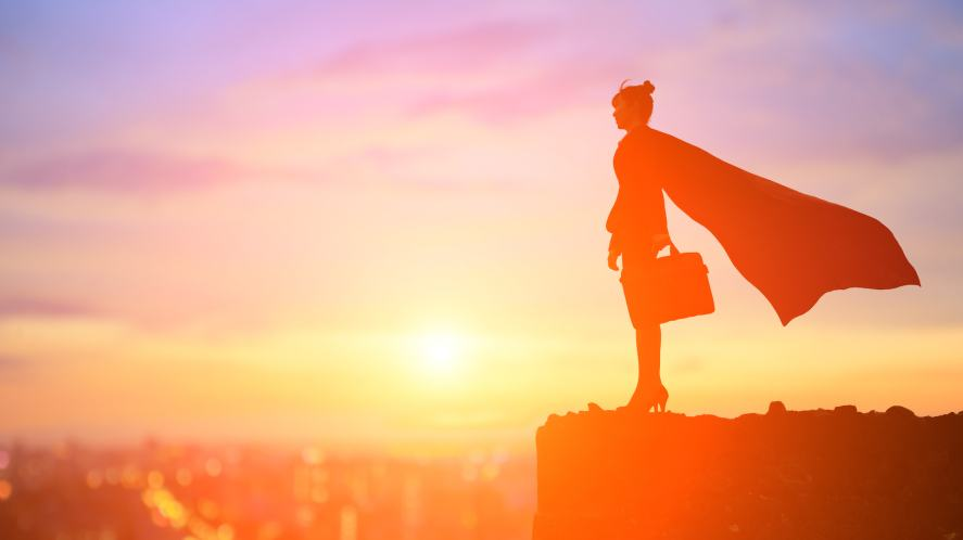 A woman wearing a superhero cape
