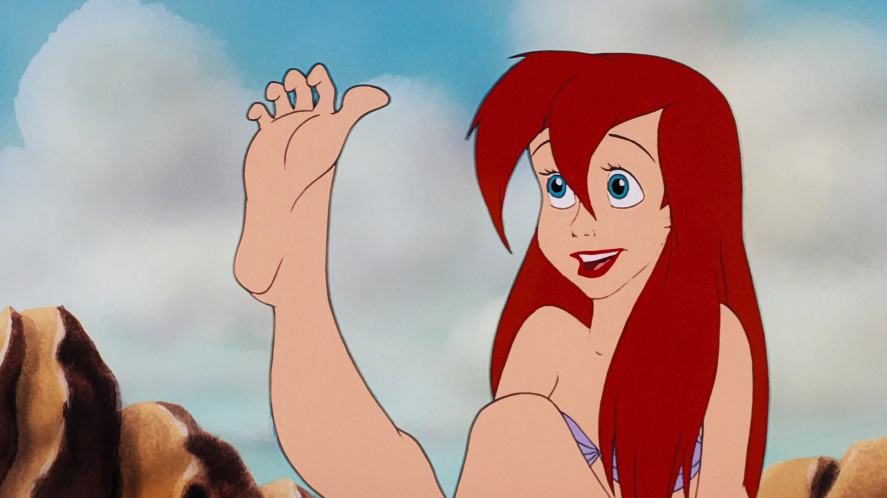 Ariel looks at her new feet