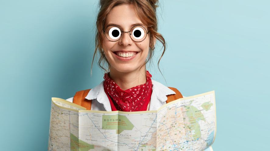 A woman holding a map
