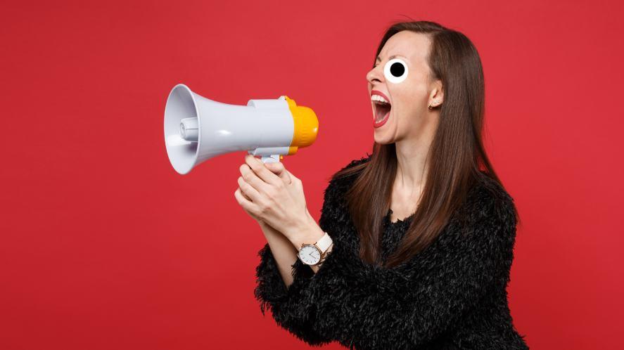 A woman shouting into a megaphone