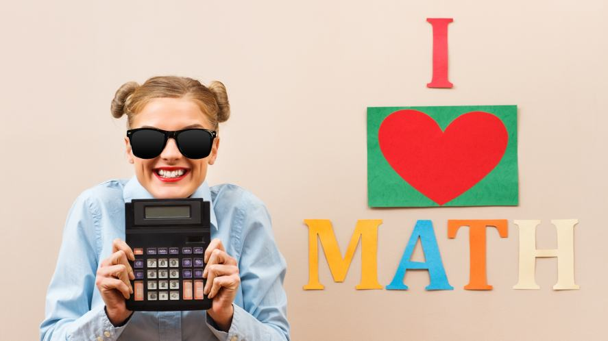 A woman standing next to a sign which reads 'I love math'