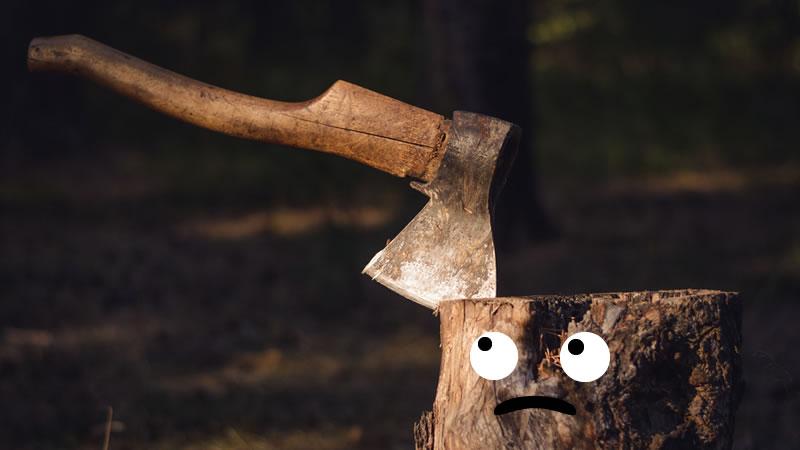 Axe in a sad log