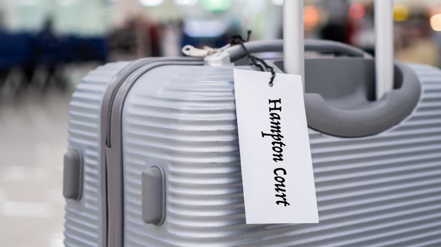 A luggage with a Hampton Court label