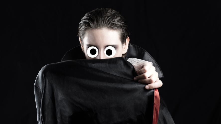 A vampire hiding behind his dark cape
