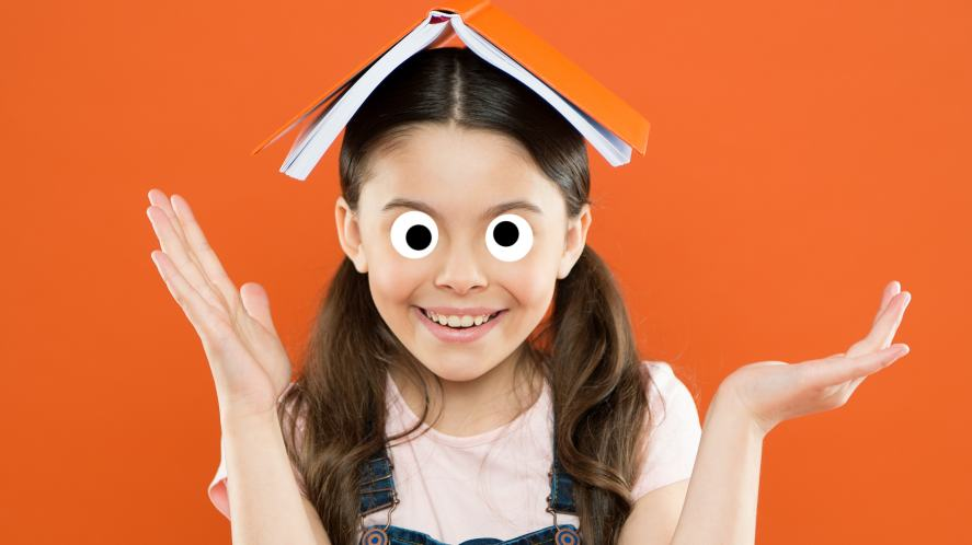 A girl balancing a book on her head