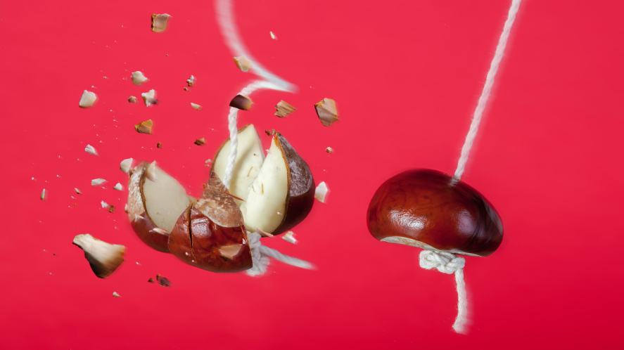 A conker shattering another conker