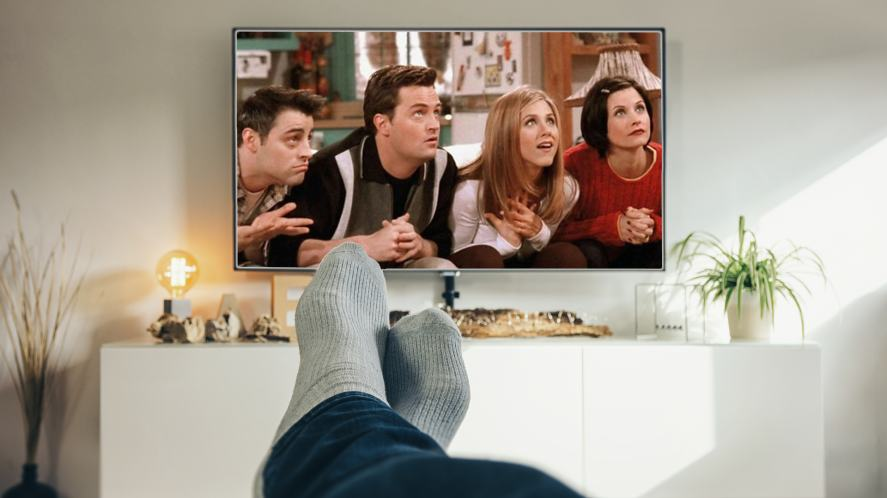 A person relaxing watching Friends