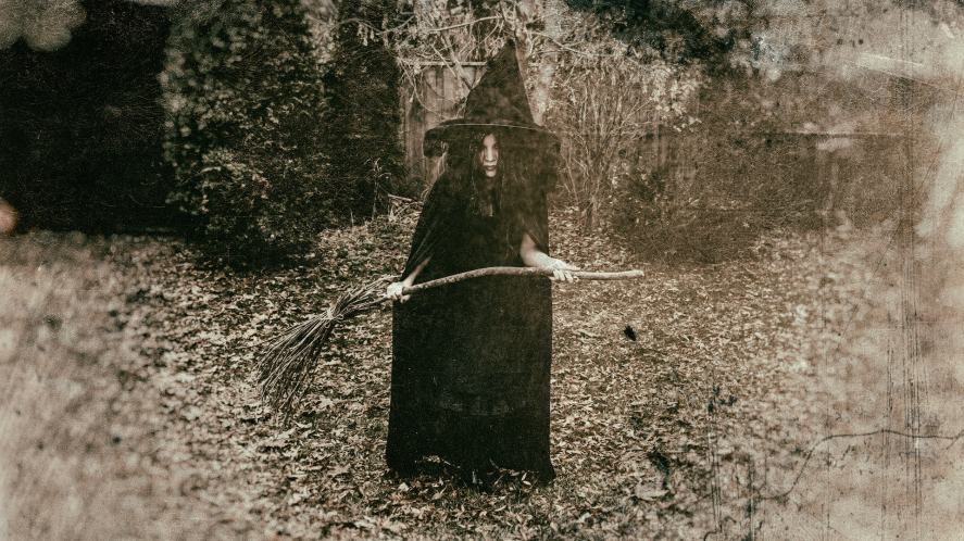 A black and white photograph of a witch